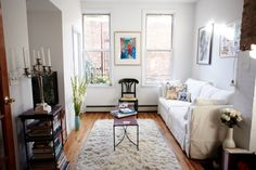 """What is your number one design tip for making small spaces look bigger?  """"Hang drapes high and wide to make the room and windows look larger."""""""