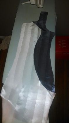 Making a contoured dress with no seams. Designed it and then Google searched. Nothing like it. The dark sides curve just under the hip and the skirt is flared instead of like a body con dress. Sheath dress, princess dress, dual color, satin stripe.