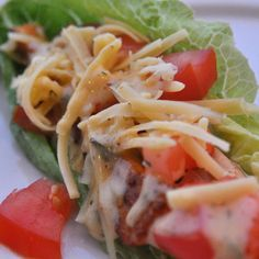 Paleo Fish tacos on romaine lettuce with a yummy homemade sauce