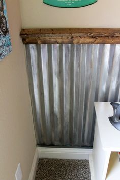 Corrugated metal as wall covering - would love it for the mudroom!