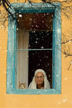 "The Woman:  ""My cat and me, this is where we like to be... Just sitting here, to watch and see.""  (Written By: © Lynn Chateau.)"