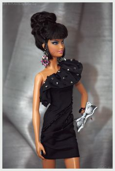 An outtake from my photo shoot with Barbie® Top Model Resort Teresa doll. She's wearing a customized (hand beaded) little black dress from Barbie Basics Collection 001.5. The earrings and bangle bracelet are also OOAK, made by yours truly.