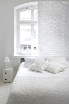 White white white but the different textures makes this bedroom pretty special.