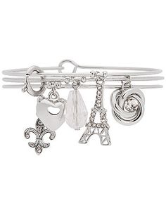 French-inspired trio of bangle bracelets lends little romance to your look with Eiffel Tower, fleur de lis and more sweet charms. Wear them as a set or pick your favorite. Smooth and textured silvertone bracelets, with hook closure. lanebryant.com