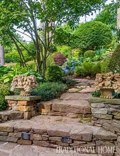 A stone path leads through the garden up from the guest cottage and outdoor dining nook. - Photo: Rob Cardillo