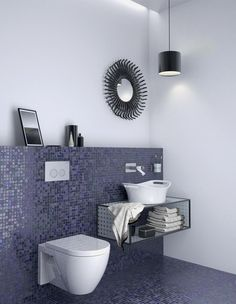 A Geberit Sigma20 flush plate with wall-mounted toilet pops against the purple tile backdrop in this modern powder room.