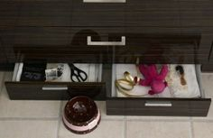 Use hidden space, such as plinth drawers - most kitchen designers have them in their range.