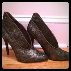 Heel Beautiful shootie. Never worn! 4 1/4 inch heel. Gray fur with almost a shimmer to them. Suede dark taupe trim. Slip on. Man made sole. These are for you if you love a big heel! Nothing wrong with them. Just never wore them. Nine West Shoes Heels