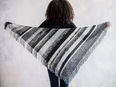 Hold two strands together to create the rich color treatment in this fringed shawl.