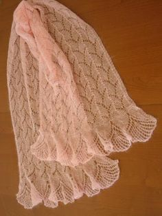 I like the scalloped edges of this knit lace scarf.