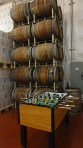 Foosball and wine barrels in the tasting room at Adelbert's Brewery in Austin, Texas