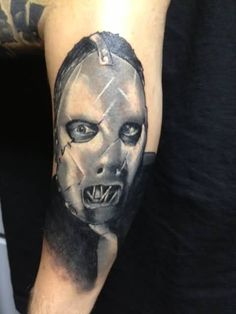 Black And White Slipknot Face Portrait Tattoo On Sleeve