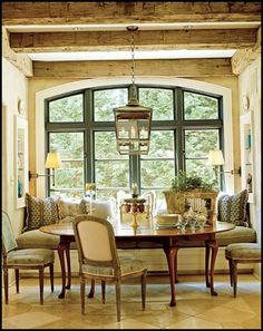 Has a view, comfy seating, stylish colors and materials, the table is round and fills the room well -- a dnner party could last all night here.