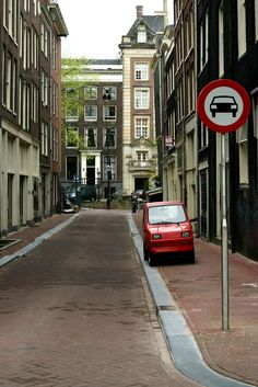 Small car in a small street in Amsterdam.