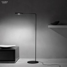 Foster + Partners' Flo floor lamps in aluminum and steel by Lumina Italia.