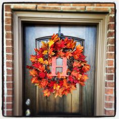 I'm so making this Fall wreath - I have the wreath already and bought a B today and spray painted it black.