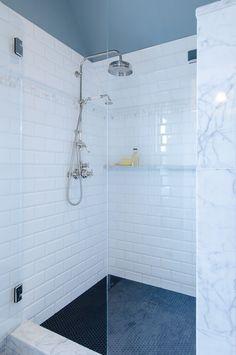 Shower floor: penny round tile 0270, Daltile; shower curb: black ceramic tile, Daltile; shower and wall tile: white subway tile with brick j...
