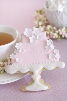 Tea and decorated cookie.