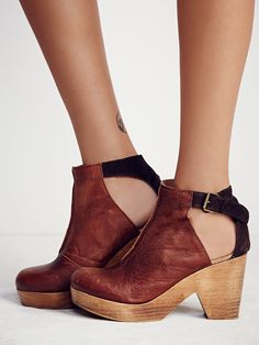 Amber Orchard Clog | Spanish crafted round-toe leather clog boots with side cutouts and a piece with suede in back. Adjustable ankle strap with buckle closure and wooden heels with rubber soles.