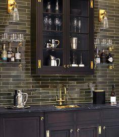 Our design mixology: Clean-lined cabinetry, with brass accents, combines with Shagreen Dark Architectonics tiles to create a sophisticated home bar that gives you reason to celebrate. #WaterworkKitchen #InteriorDesign