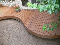 Love the idea of a raised, curved deck around the fire pit. Like: curves, wood decking
