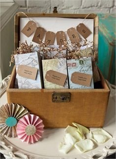 Favors wrapped in old maps @myweddingdotcom