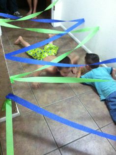Due to weather, we moved the birthday party indoors. I made this tunnel of streamers in the hallway and had the boys army crawl through it! They had a blast!