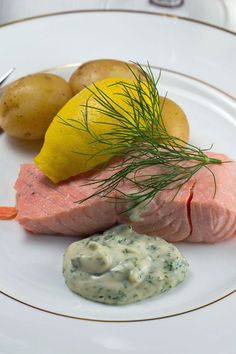 Cold poached salmon is an absolute Swedish Midsummer classic. Swedes cook the salmon by pouring boiling marinade over it and letting it cool slowly until cold. It is very easy to prepare, but obviously needs to be prepared in advance. Cold poached salmon is usually served with new potatoes and dill mayonnaise, as shown above.
