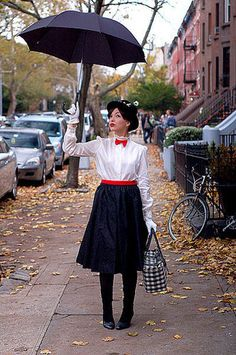 Mary Poppins is definitely one supercalifragilisticexpialidocious Halloween costume! Don't forget your umbrella, big bag, and a red tie to make this costume as sweet as a spoonful of sugar.                   Source: Keiko Lynn