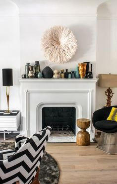 Love this living room with the beautiful White Bamileke Feather Headdress!   Interior design by Shirley Meisels MHouse Inc. Toronto www.mhouseinc.com