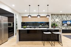 The Nova 31 Display by Mojo Homes NSW. #kitchendesign #wallpaper #blackmarble #australiandesign #blacktapware #caroma #bold #interiordesign #luxury #styling #homedecor #livingspace #sophistication #newhome #pendantlights #kitchenstools #weeklyhometrends @mojohomesint http://www.mojohomes.com.au/