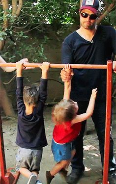 Misha and his munchkins, West & Maison. <3 HOT DAD