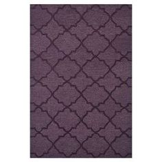Hand-tufted rug with a Moroccan tile motif.  Product: RugConstruction Material: 100% PolyesterColor: PlumFeatures: Hand-tufted Note: Please be aware that actual colors may vary from those shown on your screen. Accent rugs may also not show the entire pattern that the corresponding area rugs have.Cleaning and Care: Clean spills immediately by blotting with a clean sponge or cloth. Vacuum carefully without beater bar. Professional cleaning recommended. Rug pad recommended for use on hard…
