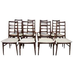 Set of 8 Koefoeds Hornslet Teak Dining Chairs Mid-Century Danish | From a unique collection of antique and modern dining room chairs at http://www.1stdibs.com/furniture/seating/dining-room-chairs/