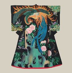 """Taisho Uchikake - Taisho (1912-1926). A vivid and remarkable silk wedding kimono featuring a masterful depiction of a phoenix and paulownia and peony flowers. The patterning technique is yuzen on a smooth, plain-spun high quality silk. 49"""" across sleeves x 61"""" height. . The phoenix and the paulownia are intimately associated in Japanese legend – the phoenix will only alight on the branches of this tree. The Kimono Gallery"""