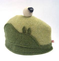 LOVE THIS!!! Now to translate it to knitting or crochet.... Wool Sheep Tea Cosy - lined