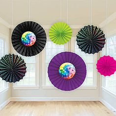 These 70's Fan Decorations feature brightly colored paper fans with mirror ball images in the center of two fans.  Sold in a package of 6.
