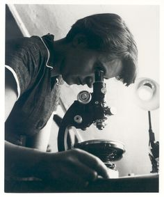 Rosalind Franklin with microscope, 1955