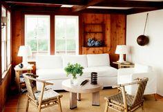 Hamptons living room with wood paneled walls.