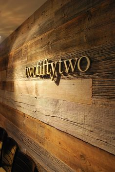 letters on reclaimed wood: The similar colors really help the sign display fit into it's surroundings.