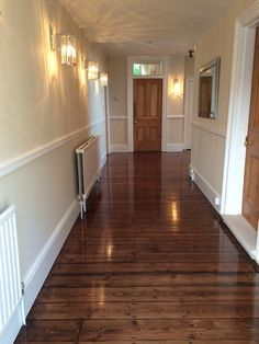 Pine floorboards sanded and finished by Restore My Floor.