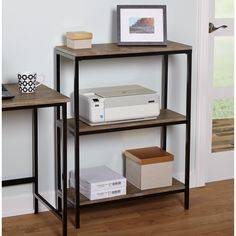 The Piazza 3-tier bookshelf from Simple Living features a bold black metal frame accented with reclaimed look natural finish surface that can blend with any decor from contemporary to modern.