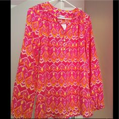 Sunrise Ikat Top NWT, beautiful top. Has three gold buttons in front, which can be buttoned down. Francesca's Collections Tops
