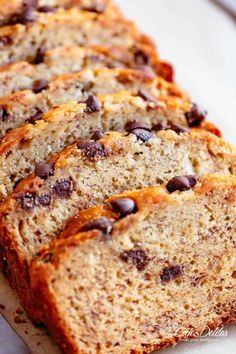 The Best Fluffy Banana Bread with chocolate chips or chopped nuts is not only the best way to use up over-ripe bananas, but it's possibly the best slice to go with your morning coffee! Better than anything store-bought, our banana bread is buttery, moist and smells amazing while baking! Every bite is pure heaven!