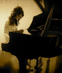 I don't know if this is a senior picture of a pianist or not, but one day, I would love to do this!!