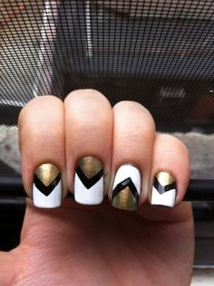 """Kathryn Clark's chevron nails are classy and sleek for the summer season. She says that she used """"Just Spotted the Lizard"""" from the new OPI Spider-Man collection to create her nail art. We love her take on the chevron trend!"""
