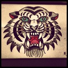Traditional style tiger flash watercolor tattoo