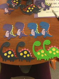 """January dinosaur door decs!! My bulletin board is """"don't let this year be a disaster- tips to a great year"""" Dino themed board with a meteor shower happening. These door tags are probably my cutest ever :) so happy with the final results"""