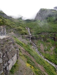 One of many waterfalls along Going to the Sun Road in Glacier National Park, Montana, USA. We drove this road when hiking Glacier National Park with Road Scholar. Lovely photo from Hiking With Barry.