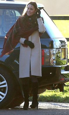 Catherine wore a knee length beige coat teamed with a tartan shawl for early morning services 25 December 2013